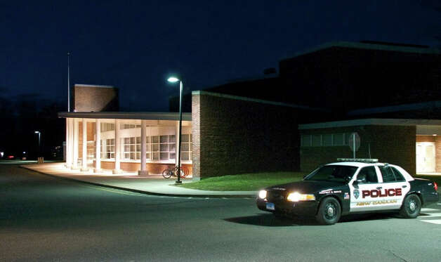 "New Canaan police are stationed outside of Saxe Middle School this evening because of a ""potential threat."" No other details are available at this time. School will be open tomorrow with a police presence. Photo by Jeanna Petersen Shepard, New Canaan, Conn., March, 14, 2013. Photo: Freelance Photo"