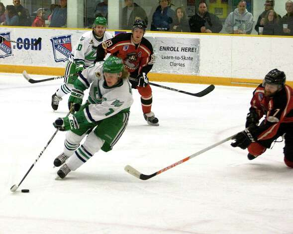 The Whalers' Mike Atkinson gets set to fire a backhander against the Thousand Islands Privateers during the FHL semifinal playoff game Saturday night, Mar. 9, 2013, at the Danbury Arena. Photo: Barry Horn / The News-Times Freelance