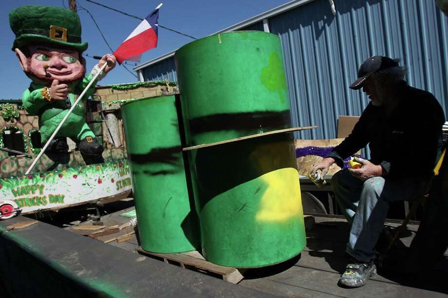 Gary Holman paints a float in preparation for the 48th Annual St. Patrick's Day Parade. Photo: Mayra Beltran, Houston Chronicle / © 2013 Houston Chronicle