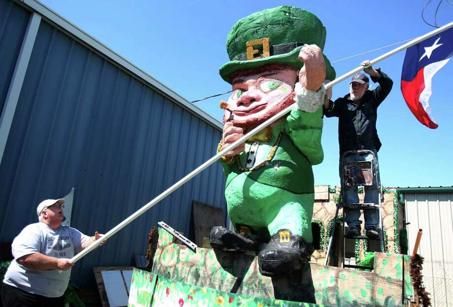 Scott Peterson and Gary Holman work on measuring the plastic pole that the leprechaun will be holding for the 48th Annual St. Patrick's Day Parade. Photo: Mayra Beltran, Houston Chronicle / © 2013 Houston Chronicle