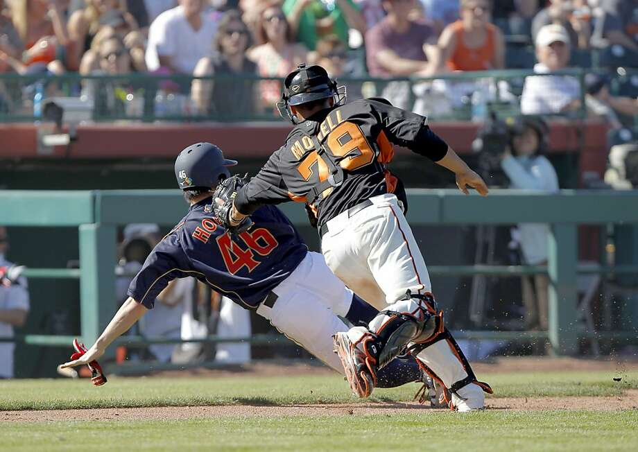 Catcher Johnny Monell chases Yuichi Honda for an out at home plate in the sixth inning, when Japan took a 6-1 lead. Photo: Michael Macor, The Chronicle
