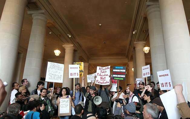 The City College protesters briefly occupy the City Hall lobby as they demand help solving the school's accreditation problems. Photo: Lance Iversen, The Chronicle