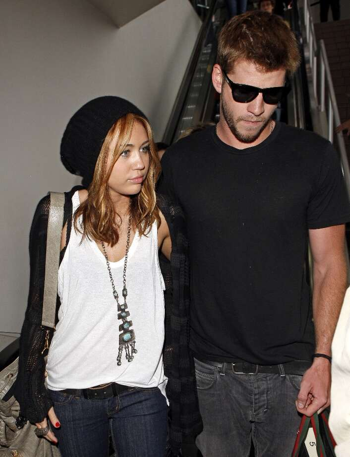 Are Miley and Liam together or splitsville? The rumors keep swirling. Here's a look at the young couple. Miley Cyrus and Liam Hemsworth arrive at LAX airport on June 21, 2010 in Los Angeles, California. Photo: Jean Baptiste Lacroix, WireImage / 2010 Jean Baptiste Lacroix