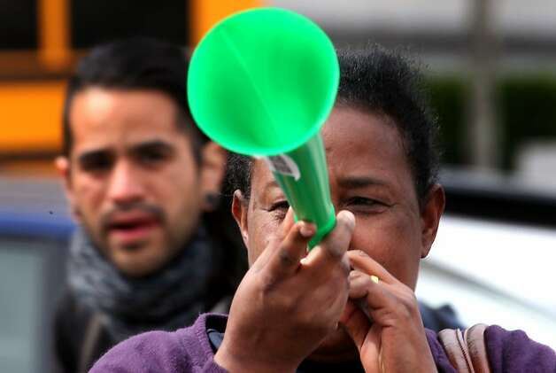Teresa Boshe blares on a vuvuzela as she joins the rally for CCSF. Photo: Lance Iversen, The Chronicle
