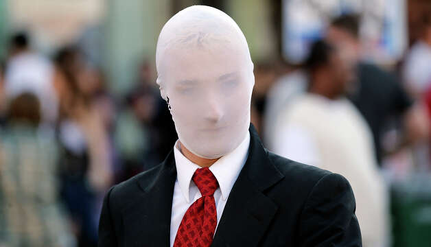 "Samuel ""Slender Man"" Gordon takes in the sights on 6th Street during South by Southwest Thursday March 14, 2013 in Austin, TX. Photo: Edward A. Ornelas, San Antonio Express-News / © 2013 San Antonio Express-News"