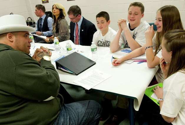 Brodus Clay of the WWE, far left, sits at a table and talks with student representatives from Rachel's Challenge before speaking at Westover Elementary School to deliver an anti-bullying message on Thursday, March 14, 2013. Photo: Lindsay Perry / Stamford Advocate