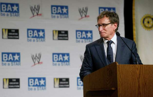 Bob Goldman of the Rotary Club of Stamford introduces representatives from anti-bullying organizations as well as stars from WWE as they deliver their message at Westover Elementary School on Thursday, March 14, 2013. Photo: Lindsay Perry / Stamford Advocate