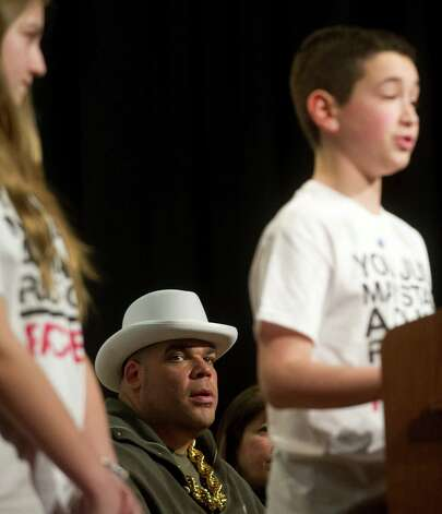 Brodus Clay of the WWE looks on as student representatives of Rachel's Challenge speak during an anti-bullying event at Westover Elementary School on Thursday, March 14, 2013. Photo: Lindsay Perry / Stamford Advocate