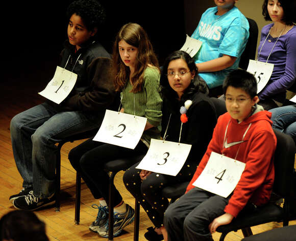 The Hearst Media Services Spelling Bee is held at Western Connecticut State University in Danbury, Conn. Thursday, March 14, 2013. From left are, Marcos Lopez, of Bridgeport, Ashley Davidson, of Stamford, Rachel Prince and Kevin Fong of Danbury. Photo: Carol Kaliff / The News-Times