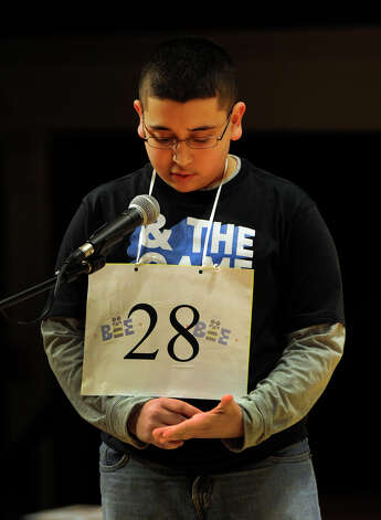 Abram Goda, of Bridgeport, spells a word during the Hearst Media Services Spelling Bee is held at Western Connecticut State University in Danbury, Conn. Thursday, March 14, 2013. Photo: Carol Kaliff / The News-Times