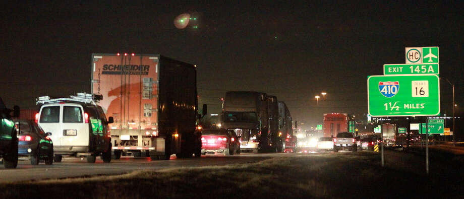 Traffic backs up on the northbound lanes of Interstate 35 near Loop 410 South and Fischer Road after a wrong-way vehicle was involved in a fatal crash. Photo: John Davenport / San Antonio Express-News