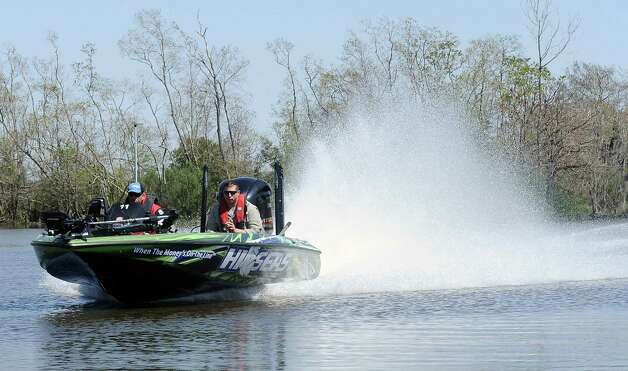 Anglers head out in search of an untapped fishing spot during the 2013 Bassmaster Elite Series Sabine River Challenge on Thursday, March 14, 2013. Photo taken: Randy Edwards/The Enterprise Photo: Randy Edwards