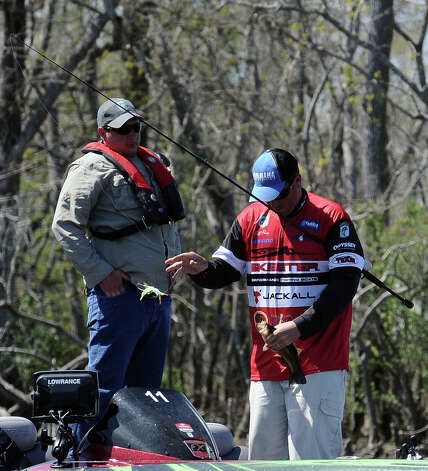 Angler Cliff Pace hooks a keeper during the 2013 Bassmaster Elite Series Sabine River Challenge on Thursday, March 14, 2013. Photo taken: Randy Edwards/The Enterprise Photo: Randy Edwards