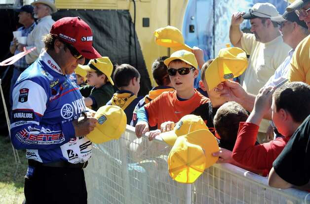 Angler Dean Rojas signs autographs after his first place weigh in during the 2013 Bassmaster Elite Series Sabine River Challenge on Thursday, March 14, 2013. Photo taken: Randy Edwards/The Enterprise Photo: Randy Edwards