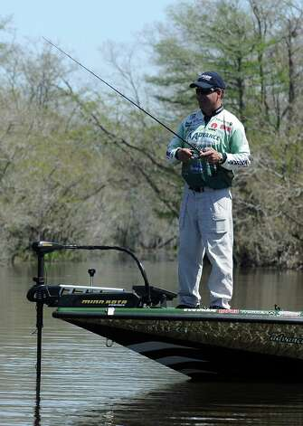 Angler Davy Hite celebrates twenty years on the water during the 2013 Bassmaster Elite Series Sabine River Challenge on Thursday, March 14, 2013. Photo taken: Randy Edwards/The Enterprise Photo: Randy Edwards