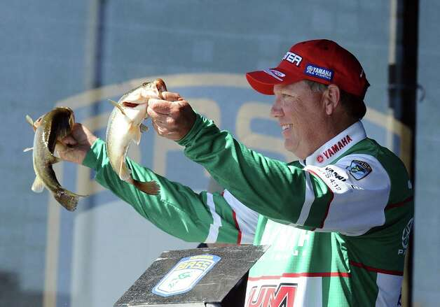 Angler Alton Jones shows his catch during the weigh in of the 2013 Bassmaster Elite Series Sabine River Challenge on Thursday, March 14, 2013. Photo taken: Randy Edwards/The Enterprise Photo: Randy Edwards