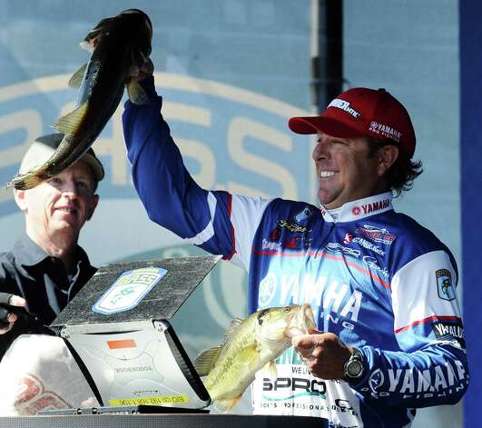 Angler Dean Rojas shows his catch during the weigh in of the 2013 Bassmaster Elite Series Sabine River Challenge on Thursday, March 14, 2013. Photo taken: Randy Edwards/The Enterprise Photo: Randy Edwards