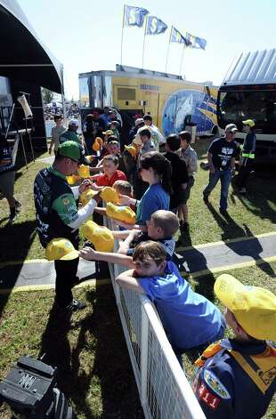 Anglers sign autographs after their weigh in for the 2013 Bassmaster Elite Series Sabine River Challenge on Thursday, March 14, 2013. Photo taken: Randy Edwards/The Enterprise Photo: Randy Edwards