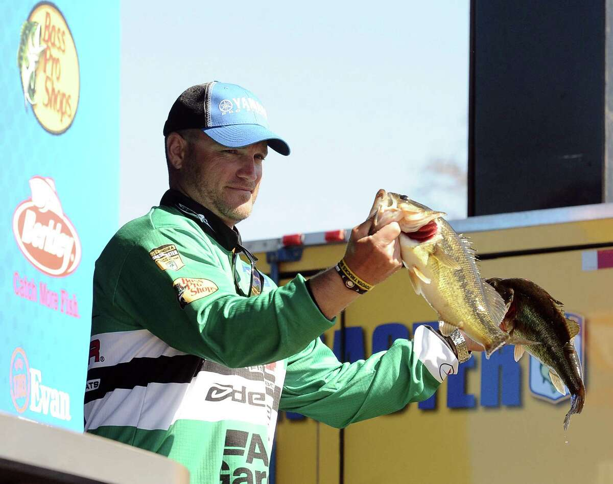 Angler Hank Cherry shows his catch during the weigh in of the 2013 Bassmaster Elite Series Sabine River Challenge on Thursday, March 14, 2013. Photo taken: Randy Edwards/The Enterprise