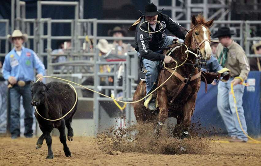 Clint Robinson competes in Tie-Down Roping during the BP Super Series Semifinals 2 at Reliant Stadiu