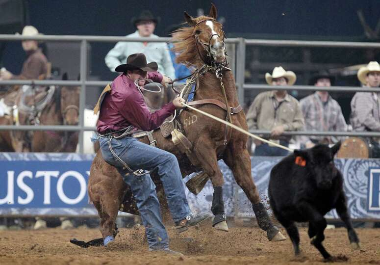 Jeremiah Peek competes in Tie-Down Roping during the BP Super Series Semifinals 2 at Reliant Stadium
