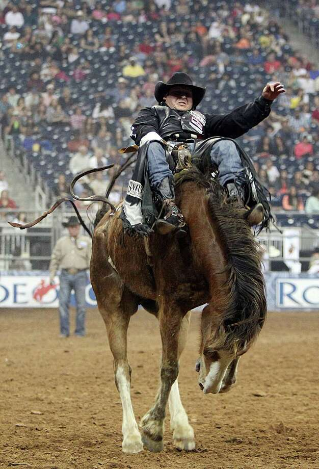 Jessy Davis competes in Bareback Riding during the BP Super Series Semifinals 2 at Reliant Stadium on Thursday, March 14, 2013, in Houston. Photo: Mayra Beltran, Houston Chronicle / © 2013 Houston Chronicle