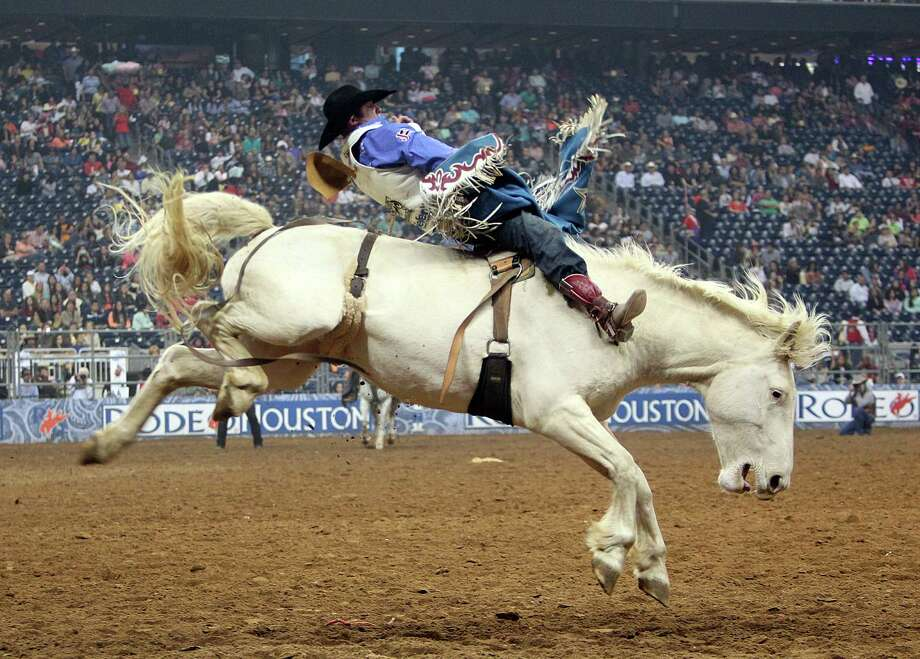 Kaycee Feild  competes in Bareback Riding during the BP Super Series Semifinals 2 at Reliant Stadium on Thursday, March 14, 2013, in Houston. Photo: Mayra Beltran, Houston Chronicle / © 2013 Houston Chronicle