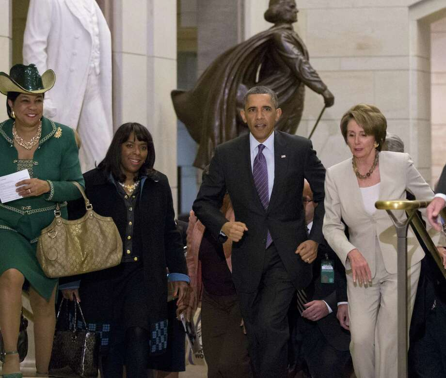 President Barack Obama, investing lots of time at the Capitol this week, leaves with Rep. Frederica Wilson, D-Fla., (from left), Rep. Terri Sewell, D-Ala., and House Minority Leader Nancy Pelosi. Photo: J. Scott Applewhite / Associated Press
