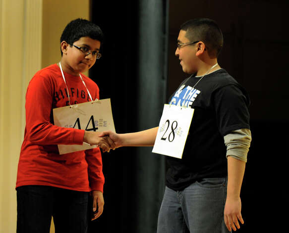 Shrenik Kankaria of Stamford, Conn., left, congratulates, Abram Goda, winner of the Hearst Media Services Spelling Bee, held at Western Connecticut State University in Danbury, Conn. Thursday, March 14, 2013. Photo: Carol Kaliff / The News-Times