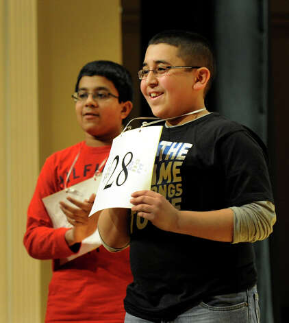 Shrenik Kankaria of Stamford, Conn., left, came in second to Abram Goda, winner of the Hearst Media Services Spelling Bee, held at Western Connecticut State University in Danbury, Conn. Thursday, March 14, 2013. Photo: Carol Kaliff / The News-Times