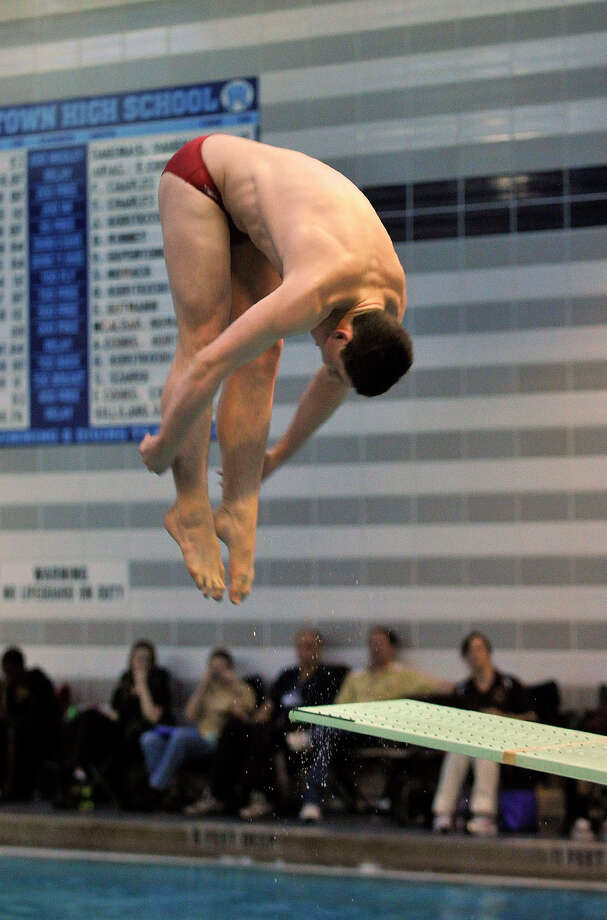 Fairfield Prep's Jake Bowtell competes in the state open diving finals at Middletown High School on Thursday, March14, 2013. Photo: Jason Rearick / Stamford Advocate