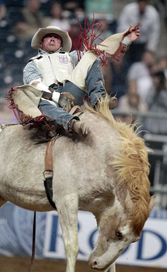 Chris Harris competes in Bareback Riding during the BP Super Series Semifinals 2 at Reliant Stadium on Thursday, March 14, 2013, in Houston. Photo: Mayra Beltran, Houston Chronicle / © 2013 Houston Chronicle