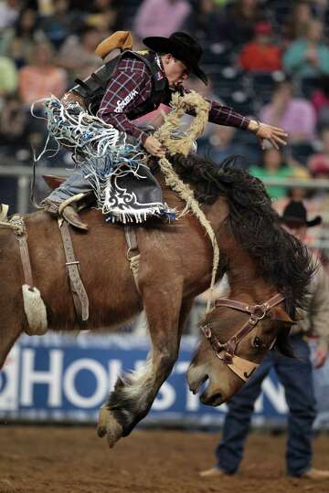 Jesse Wright competes in Saddle Bronc Riding during the BP Super Series Semifinals 2 at Reliant Stad