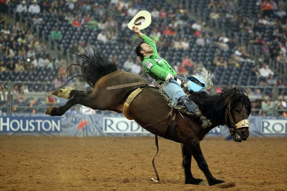 Clint Cannon competes in Bareback Riding during the BP Super Series Semifinals 2 at Reliant Stadium on Thursday, March 14, 2013, in Houston. ( Photo: Mayra Beltran, Houston Chronicle / © 2013 Houston Chronicle