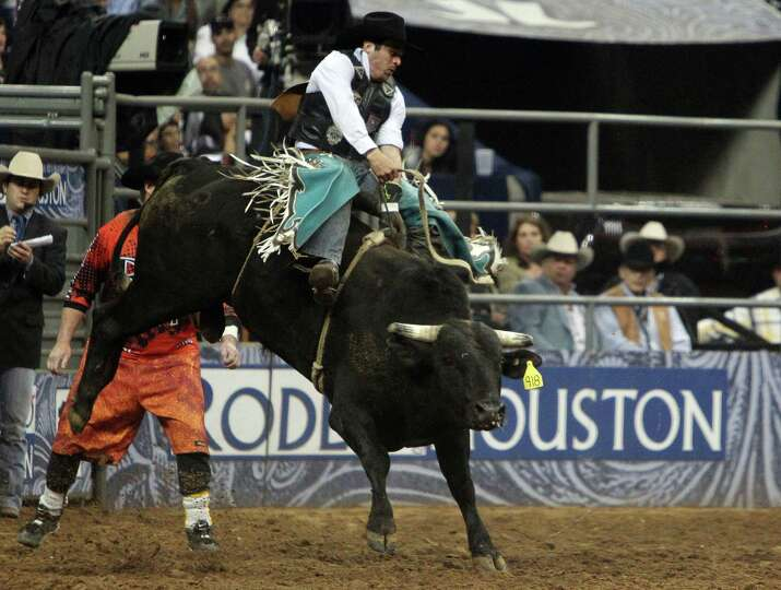 Travis Atkinson competes in Bull Riding BP Super Series Semifinals 2 at Reliant Stadium on Thursday,
