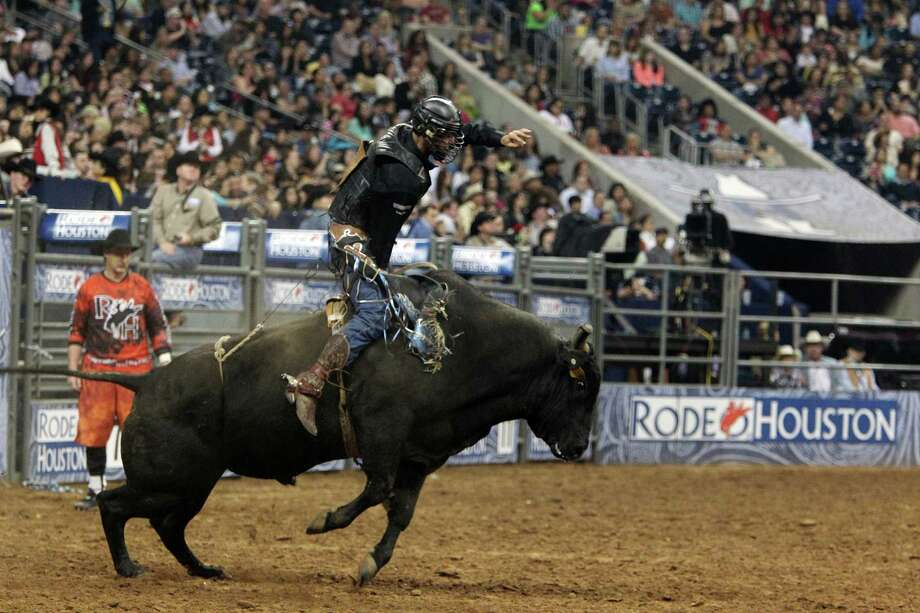 Boss Votaw competes in Bull Riding BP Super Series Semifinals 2 at Reliant Stadium on Thursday, March 14, 2013, in Houston. Photo: Mayra Beltran, Houston Chronicle / © 2013 Houston Chronicle
