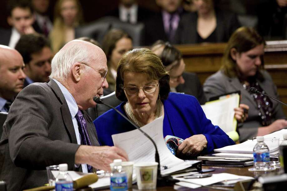 Senate Judiciary Committee Chairman Sen. Patrick Leahy, D-Vt., and Sen. Dianne Feinstein, D-Calif., confer during the hearing on a measure to reinstate a ban on assault weapons. Photo: Christopher Gregory / New York Times