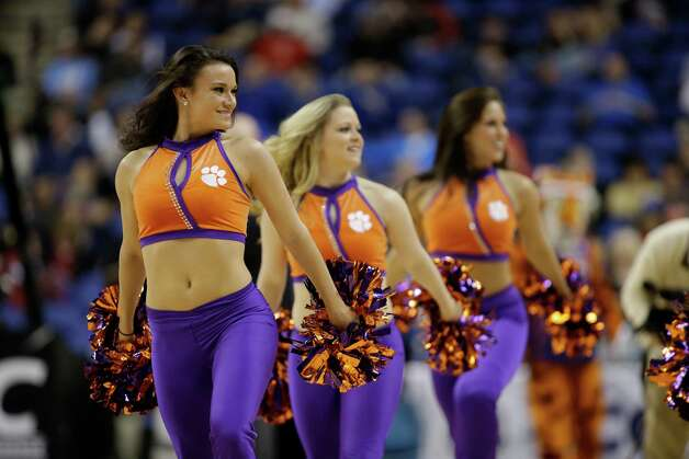Clemson cheerleaders perform during the first half of an NCAA college basketball game against Florida State at the Atlantic Coast Conference tournament in Greensboro, N.C., Thursday, March 14, 2013. (AP Photo/Bob Leverone) Photo: Bob Leverone, Associated Press / FR170480 AP