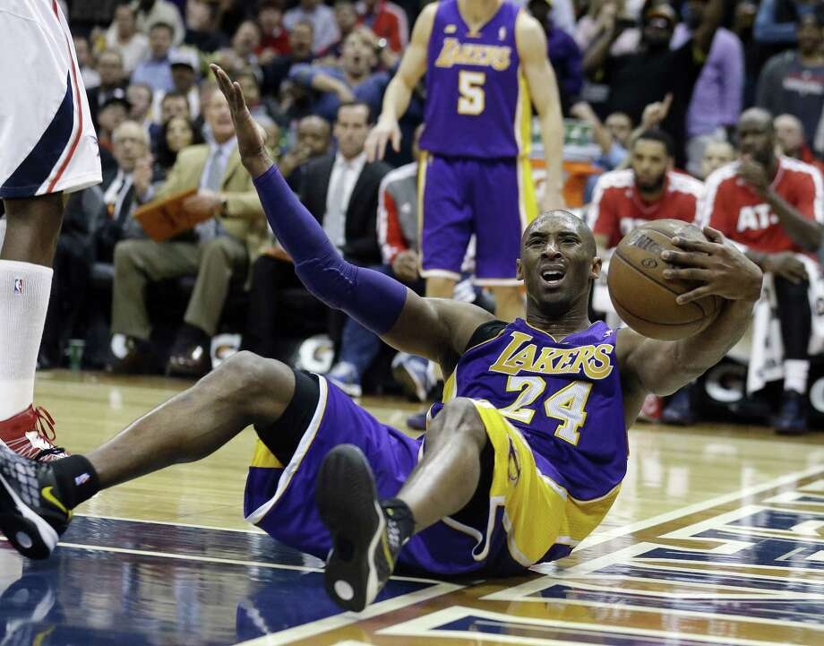 "The Lakers said Kobe Bryant, complaining to an official during the Lakers' loss to the Hawks on Wednesday, is out ""indefinitely"" with a sprained left ankle. Photo: John Bazemore / Associated Press"