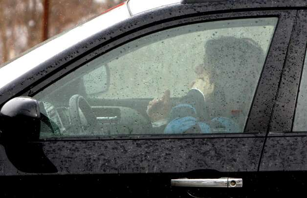 FILE - In this Feb. 10, 2010, file photo, a driver talks on a cell phone in Berlin, Vt. Distracted driving is more widespread in the U.S. than in Europe, according to a study released Thursday, March 14, 2013, that surveyed drivers about their cellphone and texting habits. More U.S. drivers reported talking on their cellphones behind the wheel than their counterparts in seven European countries, the study by the Centers for Disease Control and Prevention found. (AP Photo/Toby Talbot, File) Photo: Toby Talbot