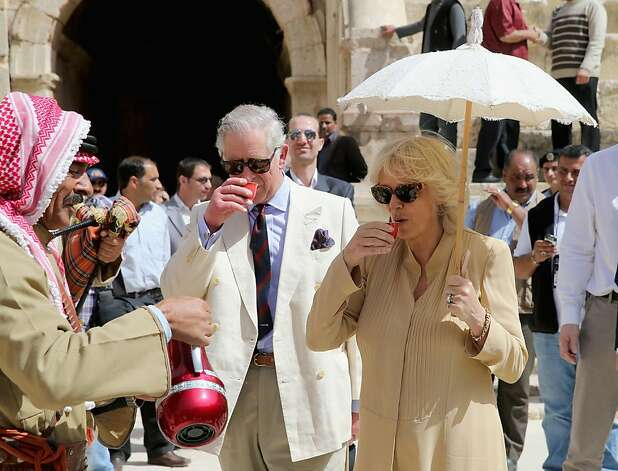 Prince Charles, Prince of Wales and Camilla, Duchess of Cornwall try the local tea as they visit the ancient Roman ruins in Jaresh on the third day of a visit to Jordan on March 13, 2013 in Jaresh, Jordan.  The Royal couple are on the first leg of a tour of the Middle East taking in Qatar, Saudia Arabia and Oman.  Photo: Chris Jackson, Getty Images