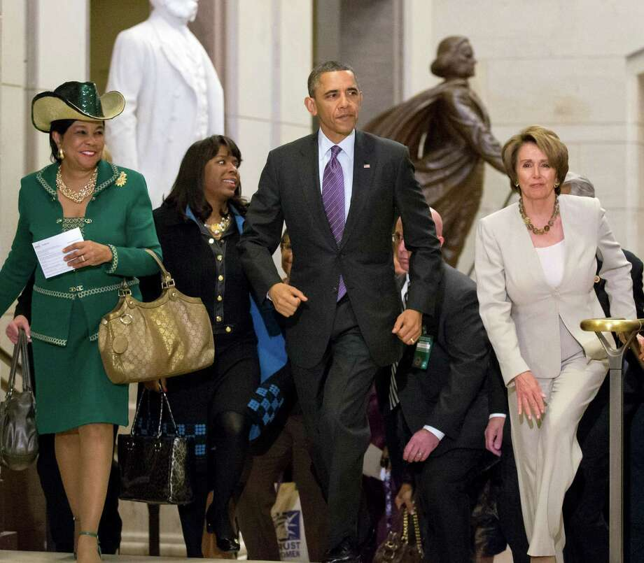 President Barack Obama and House Minority Leader Nancy Pelosi, D-Calif., leave a meeting with House Democrats at the Capitol, in Washington, Thursday, March 14, 2013. At far left is Rep. Frederica Wilson, D-Fla., with Rep. Terri Sewell, D-Ala., second from left. (AP Photo/J. Scott Applewhite) Photo: J. Scott Applewhite
