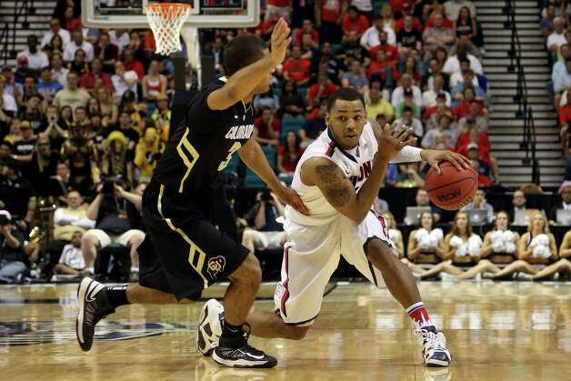 LAS VEGAS, NV - MARCH 14:  Mark Lyons #2 of the Arizona Wildcats looks to drive on Xavier Talton #3 of the Colorado Buffaloes in the second half during the quarterfinals of the Pac-12 tournament at the MGM Grand Garden Arena on March 14, 2013 in Las Vegas, Nevada.  (Photo by Jeff Gross/Getty Images) Photo: Jeff Gross