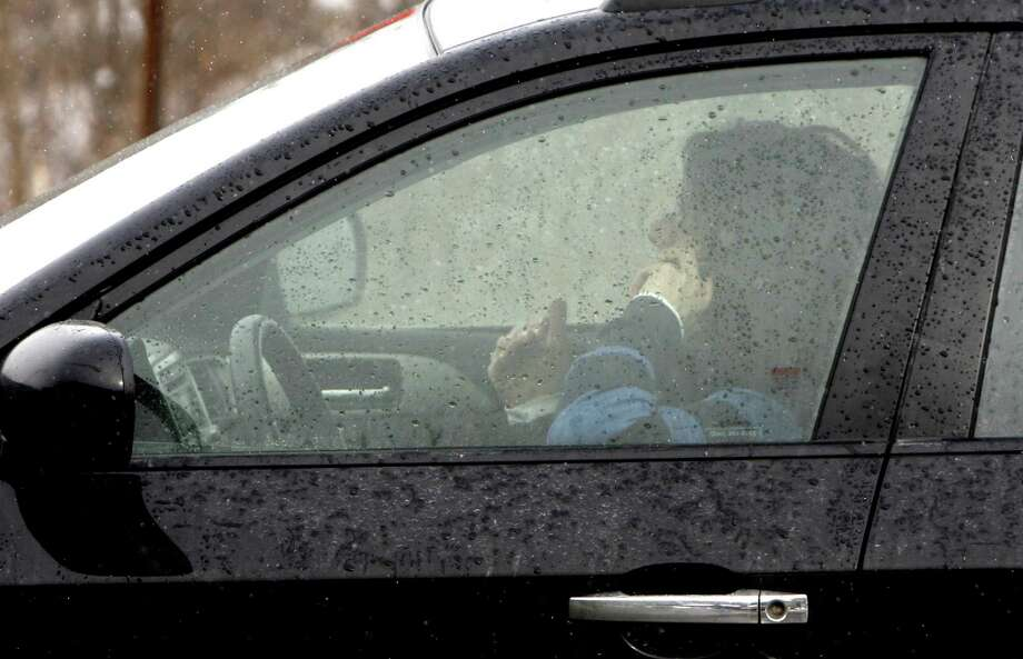 A driver on a cellphone in Berlin, Vt., according to a study, might be more apt to chat than a driver in Berlin, Germany. Photo: Toby Talbot / Associated Press