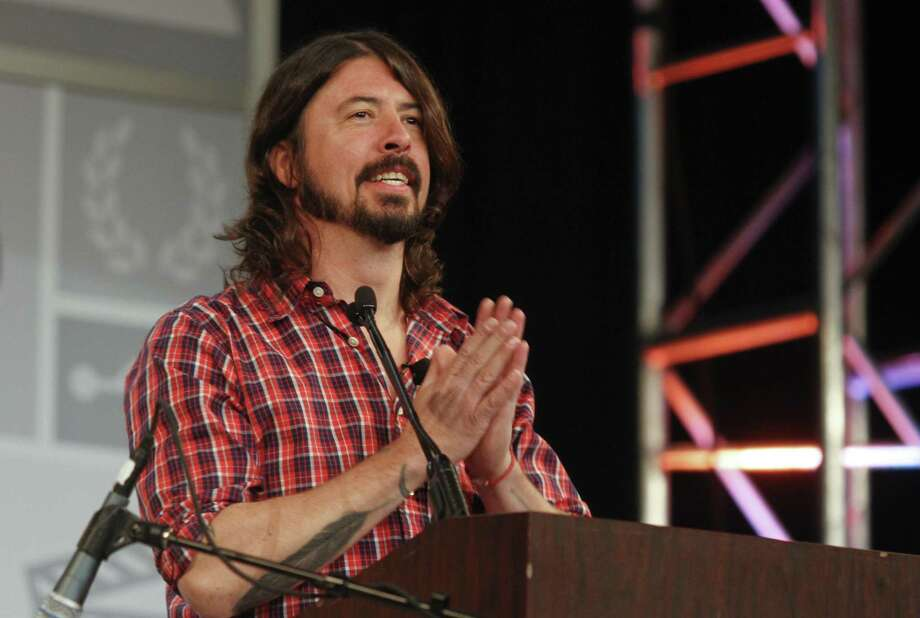 Foo Fighters frontman Dave Grohl says punk rock changed his life in 1982, when he was 13 and on vacation in Chicago. Photo: Jack Plunkett / Associated Press