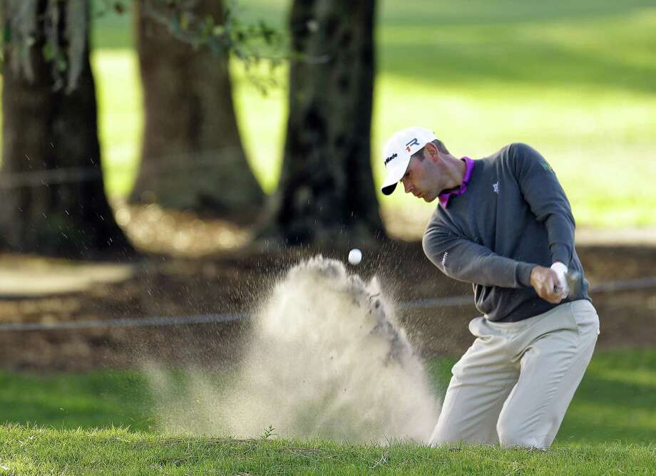 Shawn Stefani blasts from the sand trap on the fifth hole during the first round. Photo: Associated Press