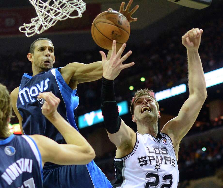 Tiago Splitter (22) of the Spurs has his shot blocked by Brandan Wright of the Dallas Mavericks during second-half action at the AT&T Center on Thursday, March 14, 2013. Photo: Billy Calzada, San Antonio Express-News / San Antonio Express-News