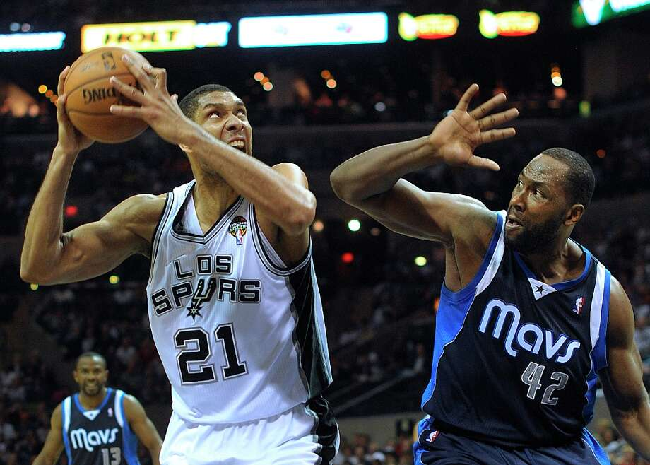 Tim Duncan (21) of the Spurs shoots as Elton Brand of the Dallas Mavericks defends at the AT&T Center on Thursday, March 14, 2013. Duncan was fouled on the play. Photo: Billy Calzada, San Antonio Express-News / San Antonio Express-News