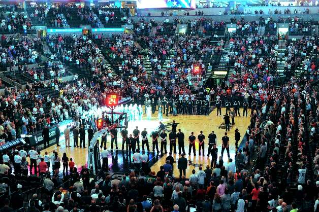 Fans and players stand as the Star-Spangled Banner is performed at the AT&T Center before the Dallas Mavericks at Spurs game on Thursday, March 14, 2013. Photo: Billy Calzada, San Antonio Express-News / San Antonio Express-News