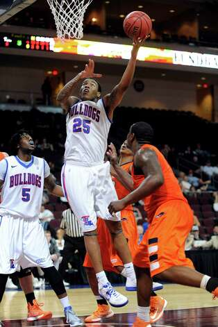 Louisiana Tech's J.L. Lewis (25) shoots against UTSA during the second half of a Western Athletic Conference tournament NCAA college basketball game on Thursday, March 14, 2013, in Las Vegas. UTSA won 73-67. (AP Photo/David Becker) Photo: David Becker, Associated Press / FR170737 AP